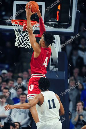 Indiana's Trayce Jackson-Davis scores in front of Penn State's Lamar Stevens (11) during the second half of an NCAA college basketball game, in State College, Pa