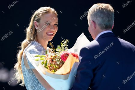 Caroline Wozniacki (L) of Denmark is presented with flowers by Tennis Australia CEO Craig Tiley (R) after being announced as the Australian Open Woman of the Year during the Australian Open Grand Slam tennis tournament at Rod Laver Arena in Melbourne, Australia, 30 January 2020.