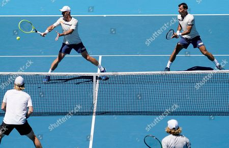 Slovakia's Filip Polasek, left, and Croatia's Ivan Dodig, right, during their doubles semifinal against Australia's Max Purcell and Luke Saville at the Australian Open tennis championship in Melbourne, Australia