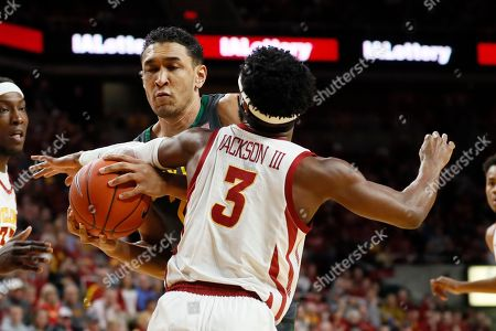 Tristan Clark, Tre Jackson. Baylor forward Tristan Clark is fouled by Iowa State guard Tre Jackson (3) while driving to the basket during the first half of an NCAA college basketball game, in Ames, Iowa