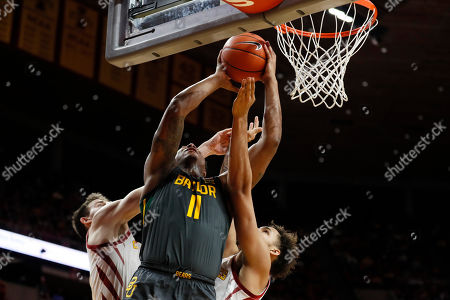 Mark Vital, Michael Jacobson, George Conditt IV. Baylor guard Mark Vital (11) drives to the basket between Iowa State's Michael Jacobson, left, and George Conditt IV during the first half of an NCAA college basketball game, in Ames, Iowa