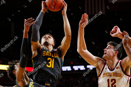 MaCio Teague, Michael Jacobson. Baylor guard MaCio Teague (31) drives to the basket past Iowa State forward Michael Jacobson (12) during the second half of an NCAA college basketball game, in Ames, Iowa. Baylor won 67-53