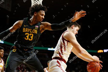 Freddie Gillespie, Michael Jacobson. Baylor forward Freddie Gillespie (33) watches as Iowa State forward Michael Jacobson tries to gather in a rebound during the second half of an NCAA college basketball game, in Ames, Iowa. Baylor won 67-53