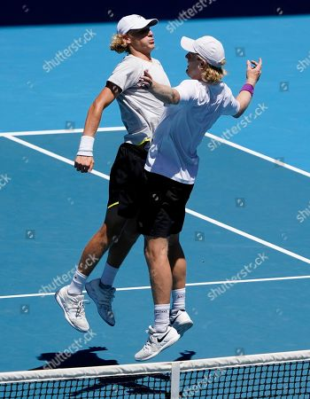 Australia's Max Purcell and Luke Saville celebrate after defeating Slovakia's Filip Polasek and Croatia's Ivan Dodig in their doubles semifinal match at the Australian Open tennis championship in Melbourne, Australia