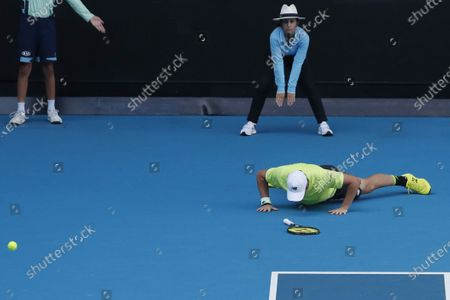 Henri Kontinen of Finland falls to the ground during his mixed doubles quarterfinal match with Gabriela Dabrowski of Canada against Latisha Chan of Taipei and Ivan Dodig of Croatia at the Australian Open Grand Slam tennis tournament in Melbourne, Australia, 30 January 2020.