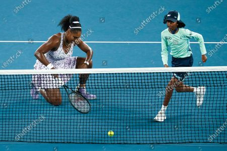 A ballkid runs to get a tennis ball as Serena Williams from the USA reacts during her women's singles second round match against Tamara Zidansek of Slovenia at the Australian Open Grand Slam tennis tournament in Melbourne, Australia, 22 January 2020 (issued 30 January 2020). Ballkids are the 'invisible players' of tennis. They clean the courts on their hands and knees, endure extreme heat to pass towels and balls to players, and brave close proximity to tennis balls flying at incredible speeds. To participate as a ballkid in the Australian Open, children must go through a difficult selection process. This includes training in ball-handling skills, rolling with precision and lessons on how to anticipate players' needs. At the Australian Open Grand Slam 2020 tennis tournament, there are 360 ballkids between the age of twelve and fifteen. Most come from Australia, but others come from as far as Korea, India, China, and France. Each child spends one hour per shift on court, followed by one hour off court. If temperatures reach a certain heat, rotations decrease to 45-minute intervals. The Australian Open is the first of the four Grand Slam tennis events run each year. This year Australian Open is held from 20 January to 02 February.