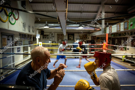 """Gerry Storey, Jack Douglas. Gerry Storey, left, an 83-year-old Catholic trainer at the Holy Family Boxing Club, spars with Jack Douglas, a protestant 19-year-old from Antrim, in Belfast, Northern Ireland. """"What we are doing here is really essential,"""" said Storey, of the club's long history of training both Catholic and Protestant boxers together. """"When you come in here, you don't talk politics. You don't swear. And there's no football jerseys. In here everybody is treated fairly and squarely. And it doesn't care who or what you are"""
