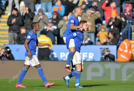 Harvey Barnes of Leicester City celebrates with Ross Barkley of Chelsea after scoring his side's first goal