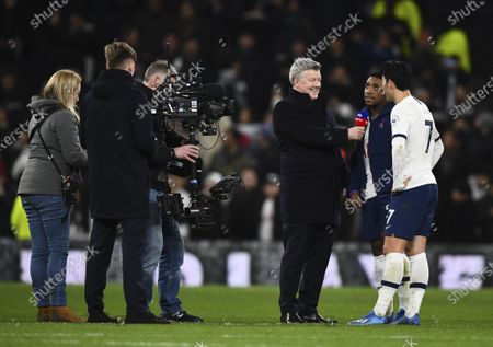 Steven Bergwijn and Son Heung-Min of Tottenham Hotspur are interviewed on the pitch by Geoff Shreeves of Sky Sports