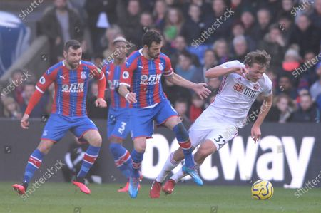 James Tomkins of Crystal Palace and Sander Berge of Sheffield United in action during the Premier League match between Crystal Palace and Sheffield United at Selhurst Park in London, UK - 1st February 2020
