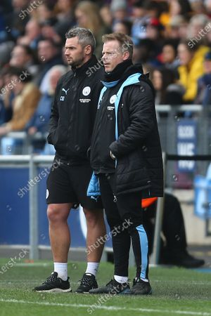 Chris Williams, goalkeeping coach and Alan Mahon, assistant manager of Manchester City