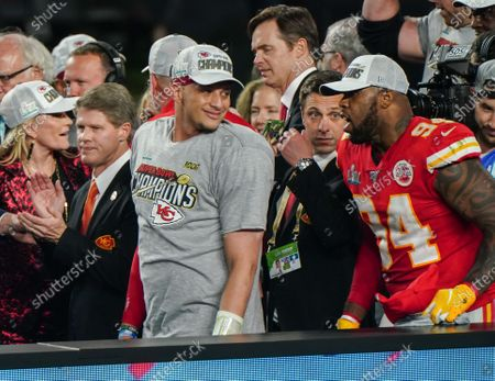 Patrick Mahomes Quarterback of the Kansas City Chiefs (15) and Terrell Suggs Defensive End of the Kansas City Chiefs (94) on the podium after the Kansas City Chiefs win Super Bowl LIV