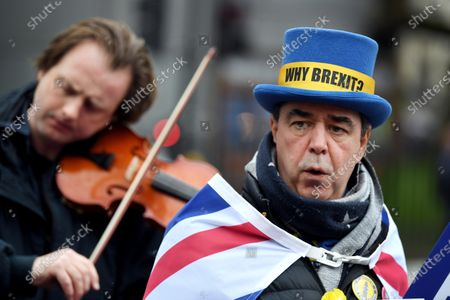 Steve Bray joins other pro-remain protesters singing Auld Lang Syne outside the Houses of Parliament Square, on the day before Britain is to withdraw from the EU.