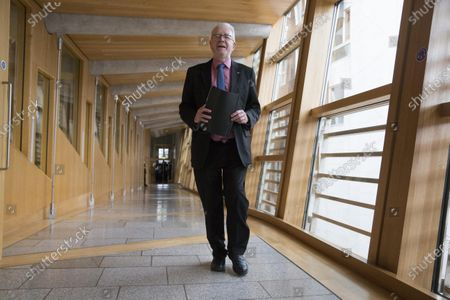 """Stock Photo of Scottish Parliament First Minister's Questions - Michael Russell, Cabinet Secretary for Government Business and Constitutional Relations or """"Brexit Minister"""", makes his way to the Debating Chamber."""