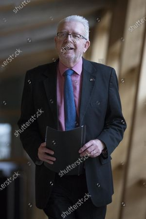 """Scottish Parliament First Minister's Questions - Michael Russell, Cabinet Secretary for Government Business and Constitutional Relations or """"Brexit Minister"""", makes his way to the Debating Chamber."""