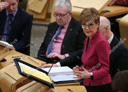 """Stock Picture of Scottish Parliament First Minister's Questions - Michael Matheson, Cabinet Secretary for Transport, Infrastructure and Connectivity, Michael Russell, Cabinet Secretary for Government Business and Constitutional Relations or """"Brexit Minister"""", and Nicola Sturgeon, First Minister of Scotland and Leader of the Scottish National Party (SNP)."""