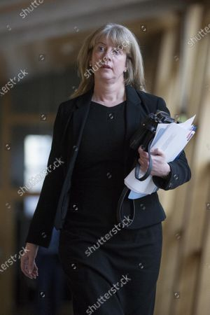 Stock Image of Scottish Parliament First Minister's Questions - Shona Robison makes her way to the Debating Chamber.