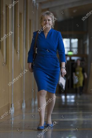Stock Picture of Scottish Parliament First Minister's Questions - Roseanna Cunningham, Cabinet Secretary for Environment, Climate Change and Land Reform makes her way to the Debating Chamber.
