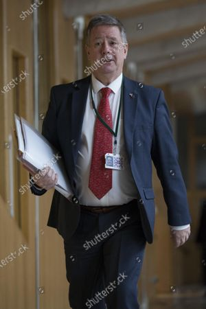 Stock Image of Scottish Parliament First Minister's Questions - Keith Brown, Depute Leader of the Scottish National Party (SNP), makes her way to the Debating Chamber.