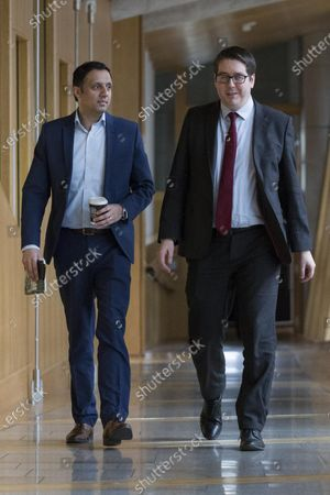 Scottish Parliament First Minister's Questions - Anas Sarwar and Neil Bibby make their way to the Debating Chamber.