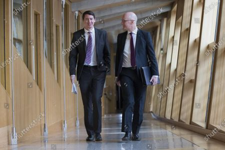 Scottish Parliament First Minister's Questions - Mark Griffin and John Swinney, Deputy First Minister and Cabinet Secretary for Education and Skills, make their way to the Debating Chamber.