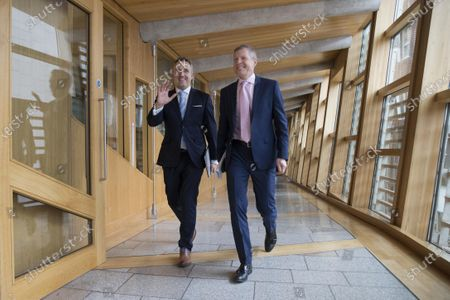 Stock Image of Scottish Parliament First Minister's Questions - Alex Cole-Hamilton and Willie Rennie, Leader of the Scottish Liberal Democrats, make their way to the Debating Chamber.