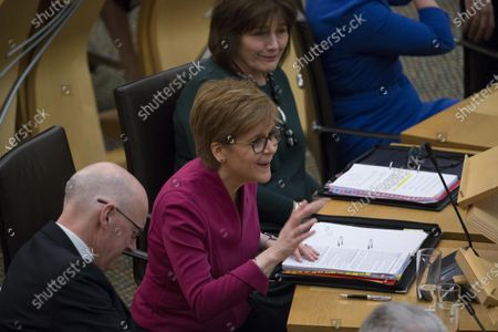 Stock Image of Scottish Parliament First Minister's Questions - John Swinney, Deputy First Minister and Cabinet Secretary for Education and Skills, Nicola Sturgeon, First Minister of Scotland and Leader of the Scottish National Party (SNP), and Jeane Freeman, Cabinet Secretary for Health and Sport.