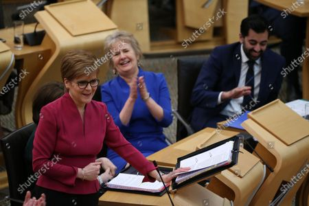 Stock Photo of Scottish Parliament First Minister's Questions - Nicola Sturgeon, First Minister of Scotland and Leader of the Scottish National Party (SNP), Roseanna Cunningham, Cabinet Secretary for Environment, Climate Change and Land Reform, and Humza Yousaf, Cabinet Secretary for Justice.