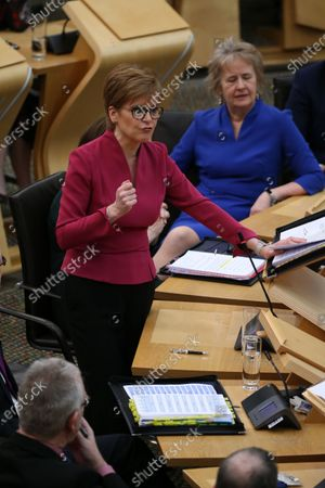 Stock Image of Scottish Parliament First Minister's Questions - Nicola Sturgeon, First Minister of Scotland and Leader of the Scottish National Party (SNP), and Roseanna Cunningham, Cabinet Secretary for Environment, Climate Change and Land Reform.