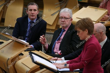 """Stock Image of Scottish Parliament First Minister's Questions - Michael Matheson, Cabinet Secretary for Transport, Infrastructure and Connectivity, Michael Russell, Cabinet Secretary for Government Business and Constitutional Relations or """"Brexit Minister"""", and Nicola Sturgeon, First Minister of Scotland and Leader of the Scottish National Party (SNP)."""