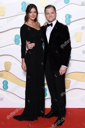 Emily Thomas and Taron Egerton