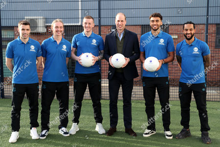 Prince William poses with players of Everton F.C. Seamus Coleman, Tom Davies, Jordan Pickford, Theo Walcott and Dominic Calvert-Lewin during his visit Everton Football Club's official charity Everton in the Community as part of the Heads Up campaign