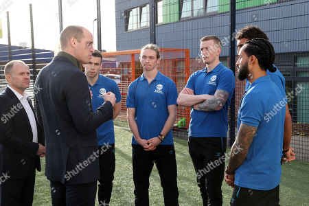 Prince William talks to players of Everton F.C. Seamus Coleman, Tom Davies, Jordan Pickford, Dominic Calvert-Lewin and Theo Walcott during his visit Everton Football Club's official charity Everton in the Community as part of the Heads Up campaign