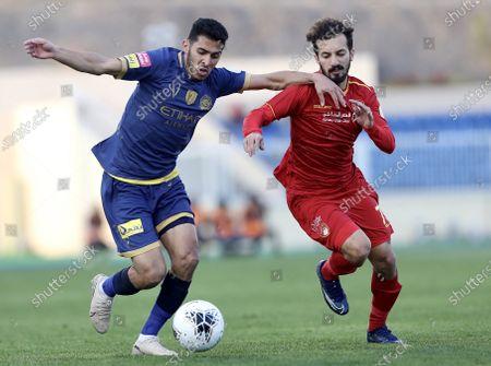 Al-Nassr's Ahmed Musa (L) in action against Damac's Bilal Al-Saidani (R) during the Saudi Professional League soccer match between Damac Club and Al-Nassr FC at Prince Mohammed bin Fahd Stadium, Abha, Saudi Arabia, 30 January 2020.