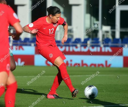 Canada's Christine Sinclair scores against St. Kitts and Nevis during a CONCACAF women's Olympic qualifying soccer match, in Edinburg, Texas. Sinclair scored her 184th goal, passing Abby Wambach for first place