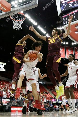 Stock Photo of Washington State forward CJ Elleby, center, grabs a rebound between Arizona State forward Kimani Lawrence, left, and forward Taeshon Cherry during the first half of an NCAA college basketball game in Pullman, Wash