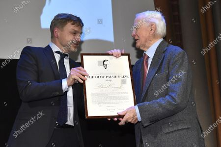 Joakim Palme hands over the Olof Palme Prize to author David Cornwell pseudonym John Le Carre at a ceremony in the Concert Hall's Grünewaldsalen