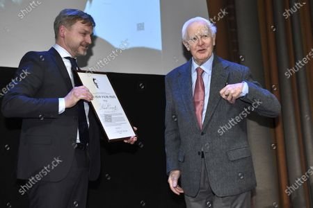 Stock Image of Joakim Palme hands over the Olof Palme Prize to author David Cornwell pseudonym John Le Carre at a ceremony in the Concert Hall's Grünewaldsalen
