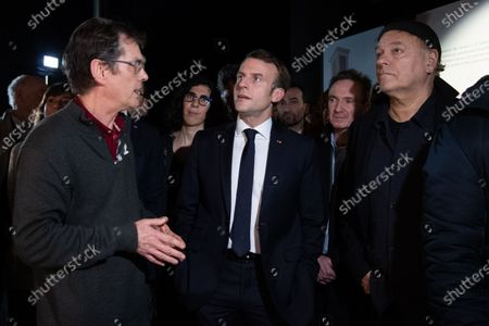 French President Emmanuel Macron (C) with Serbian director and designer Enki Bilal (R) during a visit to the exhibition 'In the head of Pierre Christin' during Angouleme Comics Festival 2020, at  Angouleme, Southwestern France, 30 January 2020.