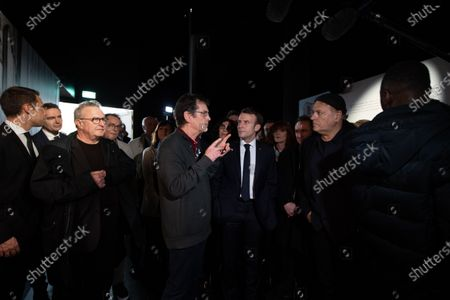 Stock Photo of French President Emmanuel Macron (3-R) with Serbian director and designer Enki Bilal (2-R) during a visit to the exhibition 'In the head of Pierre Christin' during Angouleme Comics Festival 2020, at  Angouleme, Southwestern France, 30 January 2020.