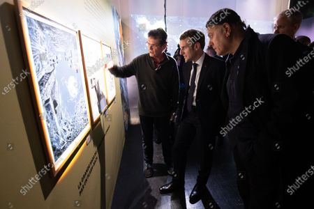 Stock Image of French President Emmanuel Macron (C) with Serbian director and designer Enki Bilal (R) during a visit to the exhibition 'In the head of Pierre Christin' during Angouleme Comics Festival 2020, at  Angouleme, Southwestern France, 30 January 2020.