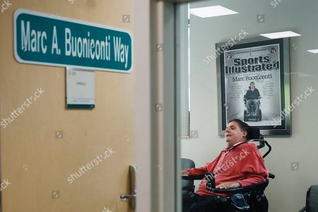 Stock Photo of Marc Buoniconti, who was paralyzed from the shoulders down making a tackle in college in 1985, poses for a portrait in his office at the The Miami Project to Cure Paralysis in Miami. As the Super Bowl returns to Miami this week, Marc has mixed feelings about the sport