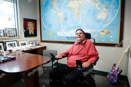 Stock Image of Marc Buoniconti, who was paralyzed from the shoulders down making a tackle in college in 1985, poses for a portrait in his office at the The Miami Project to Cure Paralysis in Miami. As the Super Bowl returns to Miami this week, Marc has mixed feelings about the sport