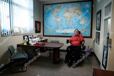 Marc Buoniconti, who was paralyzed from the shoulders down making a tackle in college in 1985, poses for a portrait in his office at the The Miami Project to Cure Paralysis in Miami. As the Super Bowl returns to Miami this week, Marc has mixed feelings about the sport