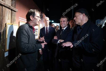 French President Emmanuel Macron (C) with French Minister of Culture Franck Riester, (2-L) and Serbian director and designer Enki Bilal (R) during a visit to Angouleme Comics Festival 2020, at  Angouleme, Southwestern France, 30 January 2020.