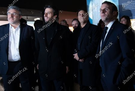 Stock Picture of French President Emmanuel Macron (R) visits the exhibition 'In the head of Pierre Christin' next to Serbian director and designer Enki Bilal (2-R) and French athlete Tony Estanguet (2-L) who develops comic book projects for the 2024 Olympic Games, during the Angouleme Comics Festival 2020, in Angouleme, Southwestern France, 30 January 2020.
