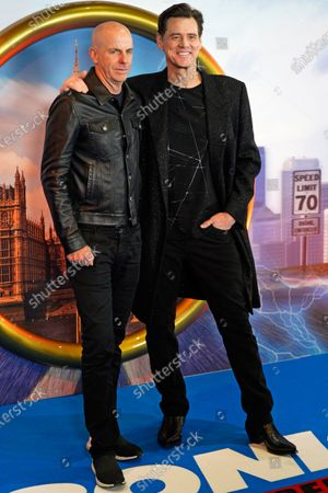 Neal H. Moritz (L) and US actor Jim Carrey pose of photographs during a gala screening of 'Sonic the Hedgehog' in Central London, Britain, 30 January 2020. The movie screens in UK cinemas from 14 February 2020.