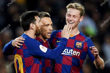 Barcelona's Brazilian midfielder Arthur Mello (C) celebrates with teammates Argentinean Lionel Messi (L) and Dutch Frenkie de Jong after scoring the 4-0 against Leganes during the King's Cup Round of Last 16 match between Barcelona and Leganes, in Camp Nou stadium, Barcelona, Spain 30 January 2020.