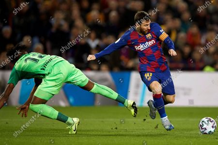 Barcelona's Argentinean striker Lionel Messi (R) fights for the ball with Legane's Nigerian defender Chidozie Awaziem during the King's Cup Round of Last 16 match between Barcelona and Leganes, in Camp Nou stadium, Barcelona, Spain 30 January 2020.