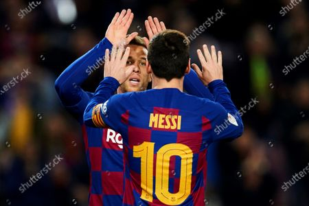 Barcelona's Brazilian midfielder Arthur Mello (back)) celebrates with teammate Argentinean Lionel Messi after scoring the 4-0 against Leganes during the King's Cup Round of Last 16 match between Barcelona and Leganes, in Camp Nou stadium, Barcelona, Spain 30 January 2020.